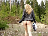 Hairy blonde Lisa T masturbates outside